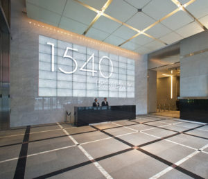 1540-Lobby-waddress-on-wall-2-people-at-desk